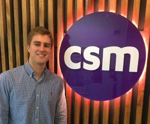 Andrew Derda poses with CSM logo
