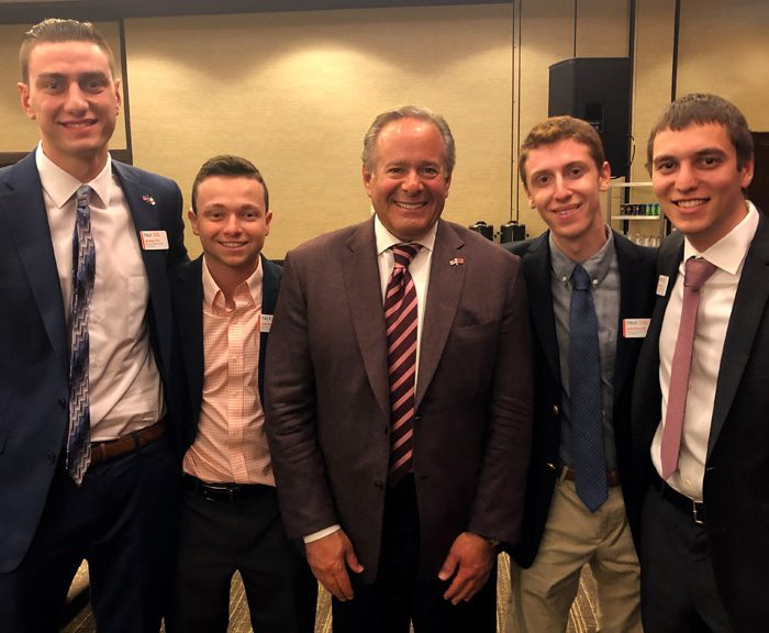 Syracuse University Trustee and alumnus Andrew T. Berlin with four Syracuse University sport analytics majors and Berlin Scholars