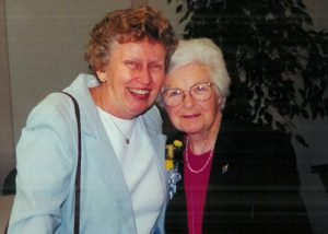 Buschle (left) with the late Alice Reynolds '60, professor emerita of nursing who served in the U.S. Army Nursing Corps in London during World War II.