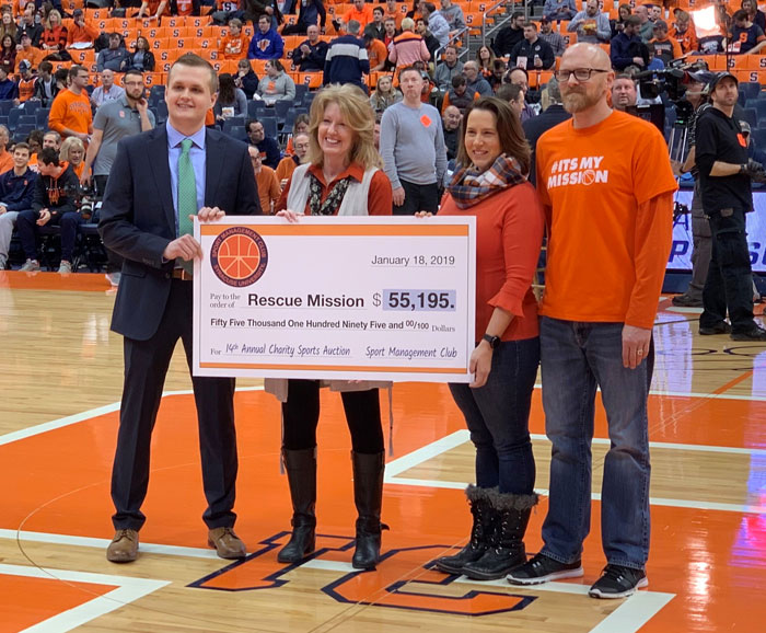 A large check is presented in the Dome