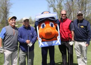 Otto posed with golfers