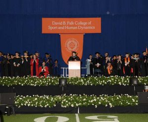 Faculty and Dean Murphy on stage during convocation