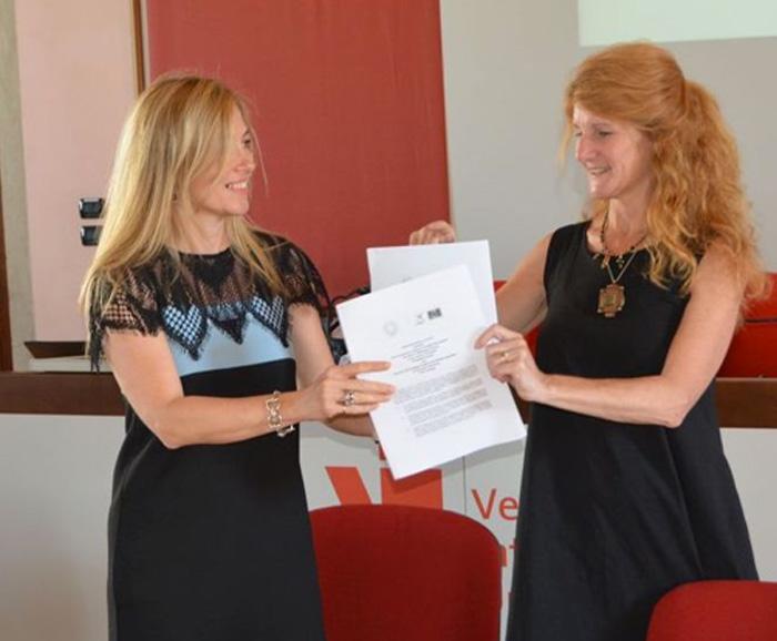 Professor Dessa Bergen-Cico posed with new agreement