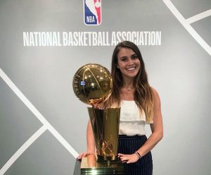 Drina Domic stands with NBA trophy