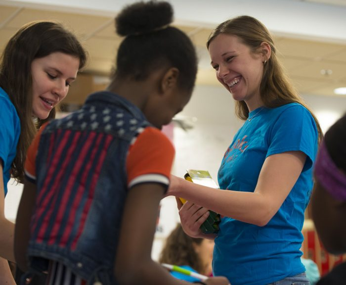 Nutrition major Elizabeth Gardner helps students at Dr. Weeks Elementary School learn about the culture and cuisine of Puerto Rico.