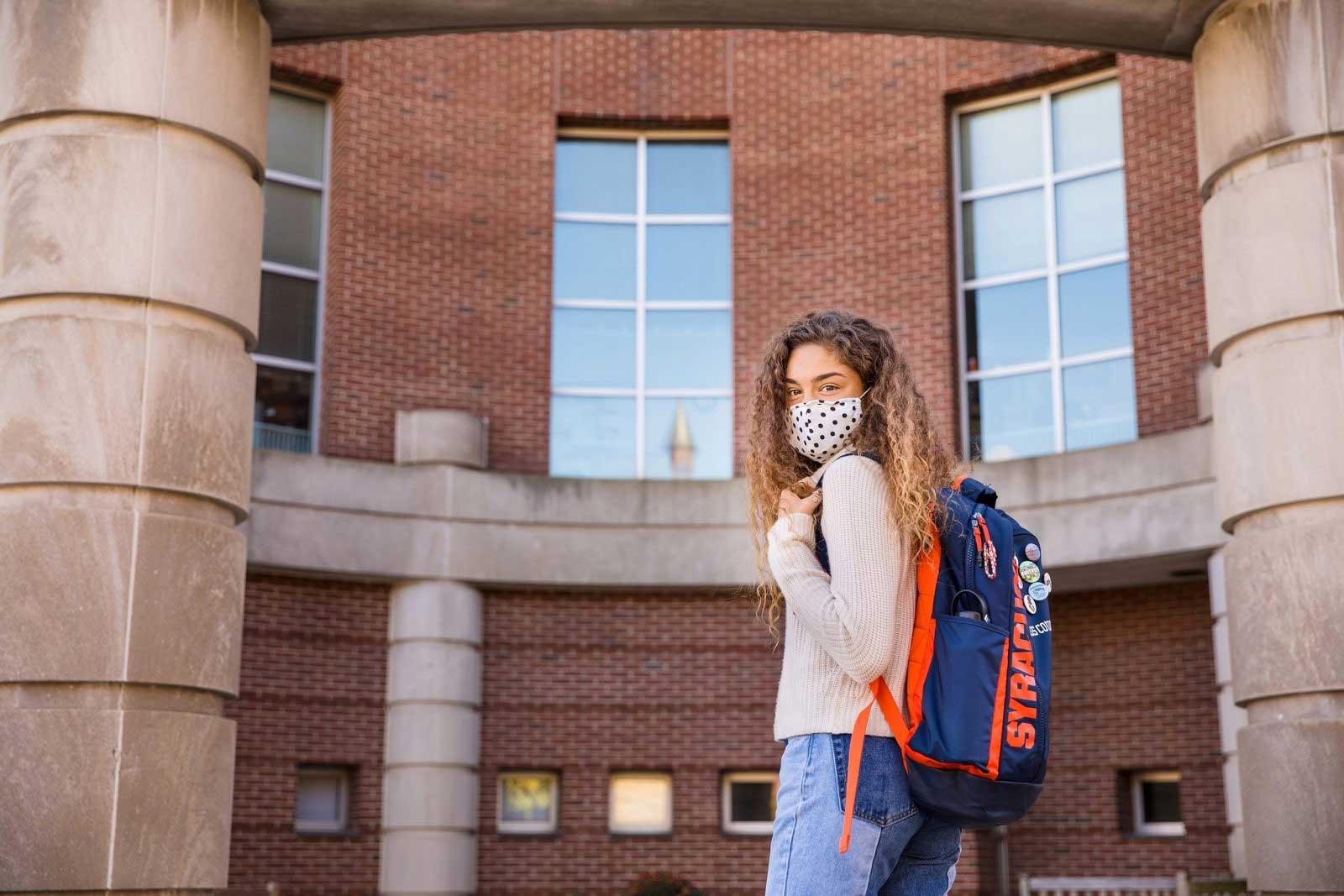 Eva Scott stands outside the Falk College complex