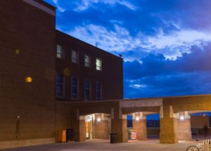 Falk College exterior at night