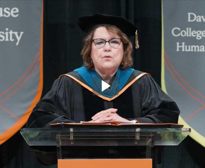 Falk College Dean Diane Murphy talks at a podium