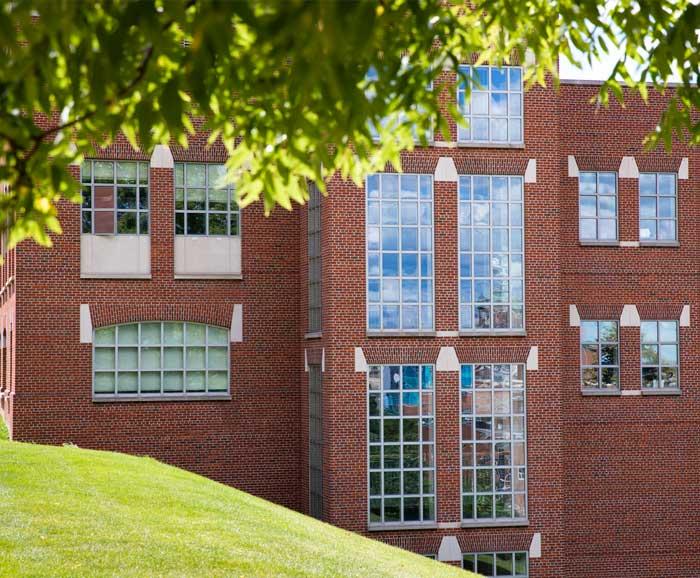 Exterior photo of the Falk College complex