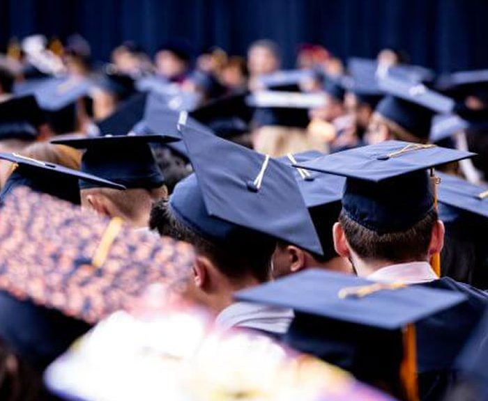 graduation hats on graduates