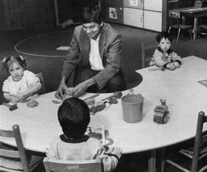 Jaipaul Roopnarine teaches at a table with three small children