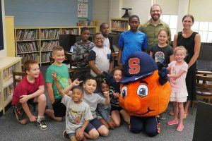 Meachem Elementary School children are posed with Otto and professor Rachel Razza