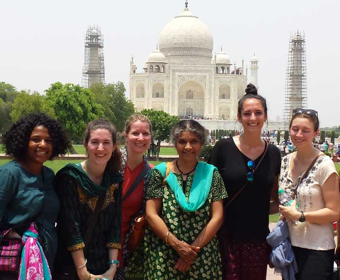 NSD students are posed with professor in front of the Taj Mahal