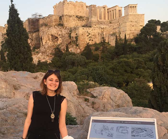 Jennifer LoPiccolo poses with a view of the Parthenon in the distance