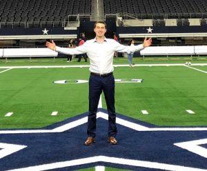 Josh Katz stands in a football stadium