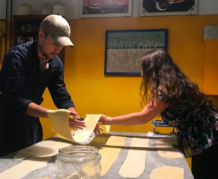 Justin Pascual making pasta in Italy as part of the Mediterranean Food and Culture course.