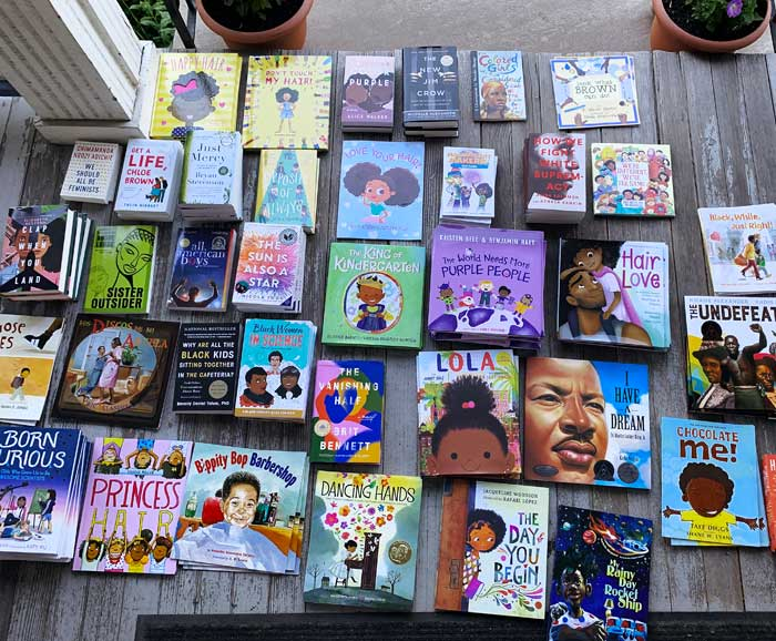 Books are laying out on a porch