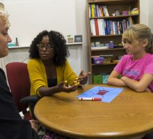Student counsels child and mom