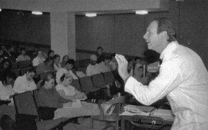 A professor talks to a classroom of students