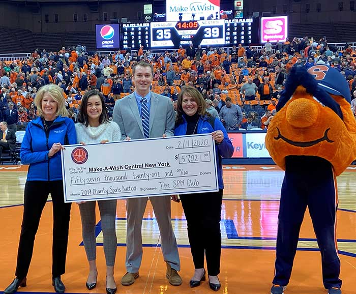 A check is presented on a basketball court during a game