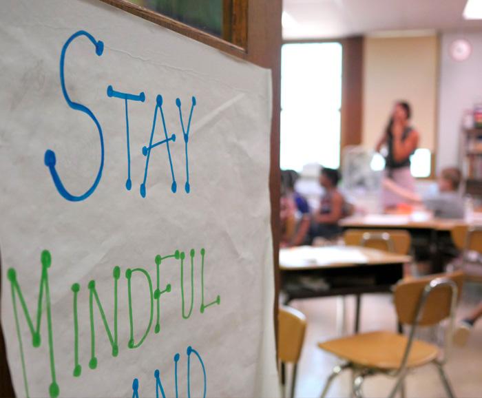 A sign on an elementary school classroom door reads