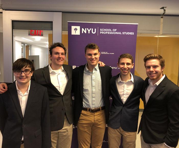 S.P.M. Students pose at NYU conference