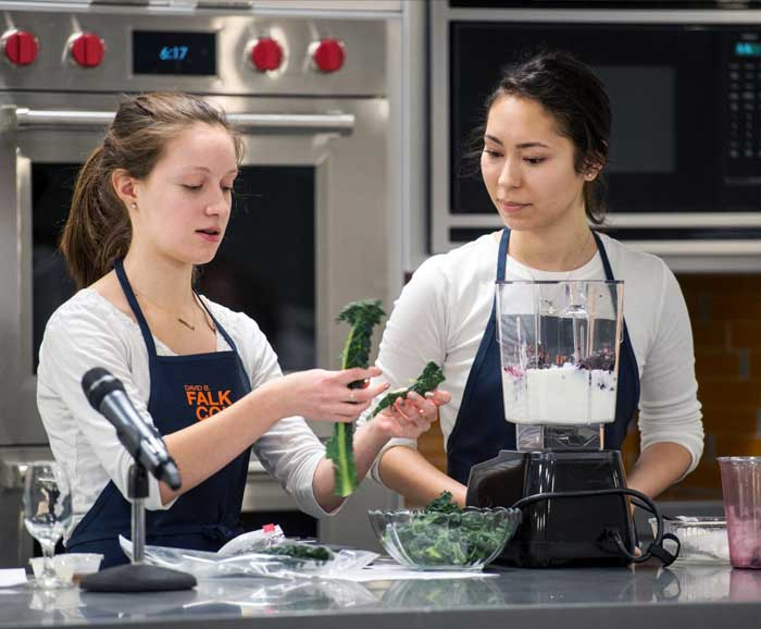 Two students cooking in a lab