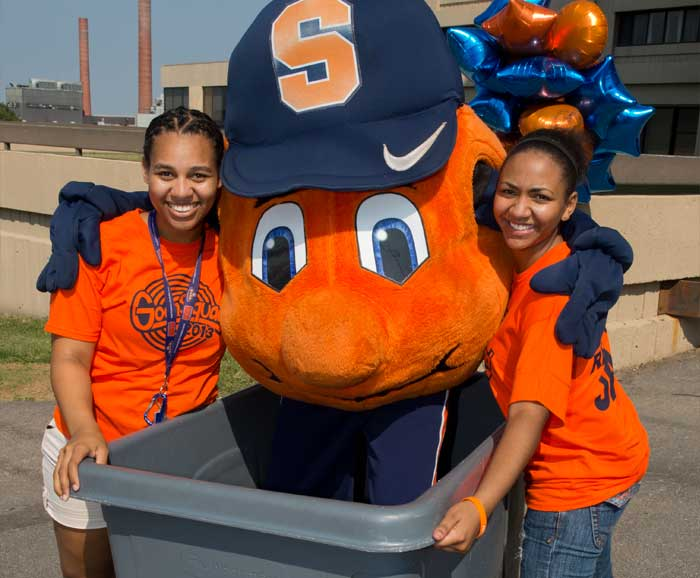 Otto with students moving in to a dorm