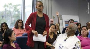 Community health educators may engage in town hall meetings to collect community concerns and share health messages.