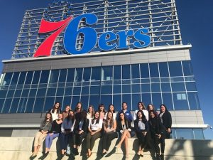 WISE group members pose in front of 76ers headquarters in Philly