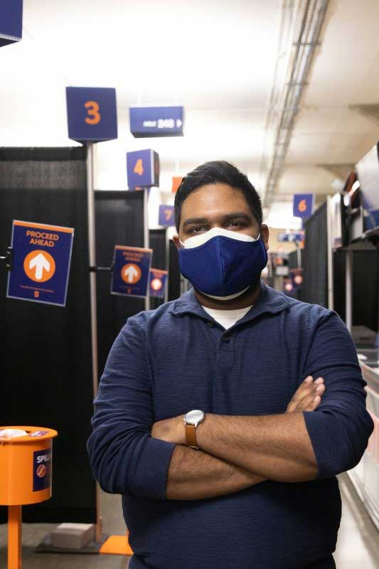 Pruthvi Kilaru stands in a COVID testing area