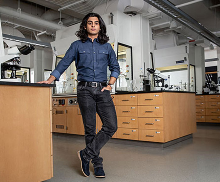 Ryan Patel stands in a lab
