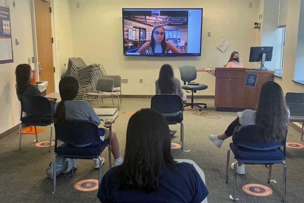 women are seated away from each other in a Zoom session