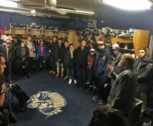 SPM Students meet with the Syracuse Crunch team in a locker room