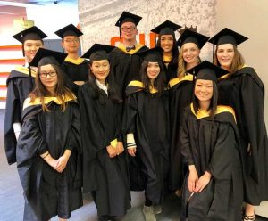 Students pose in cap and gown