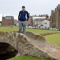 Sam Staton poses on a bridge on a golf course