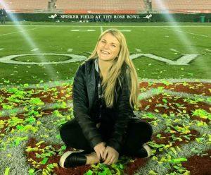 Sarah Incerpi sits on a field