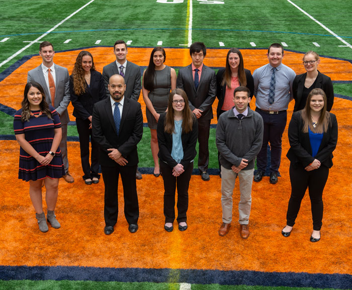 SVEM Class of 2018 posed on field in Dome