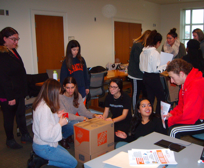 Social Work students assemble donation boxes for the 2018 food drive.