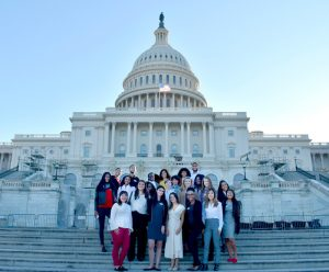 Students standing in front of the Capitol Building