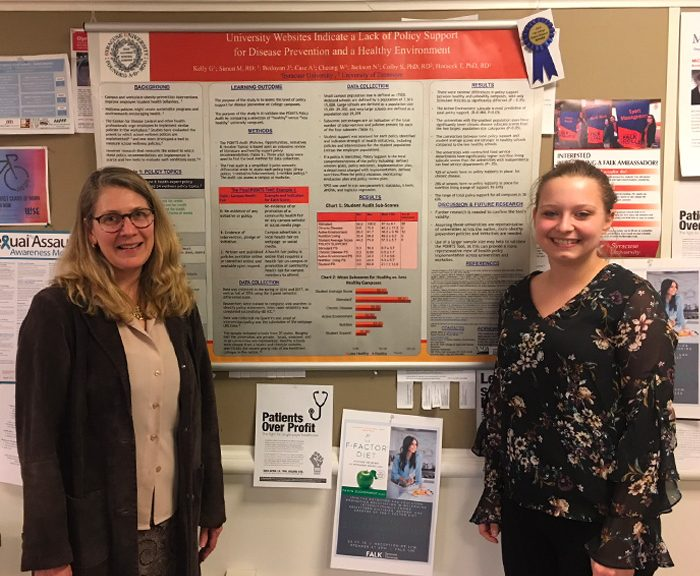 Tanya Horacek stands with Natasha Jackson in front of her winning research poster