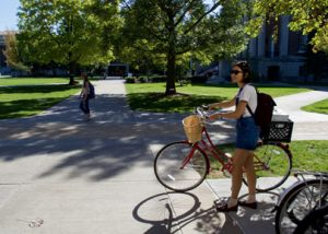 SU student on the Quad with bike
