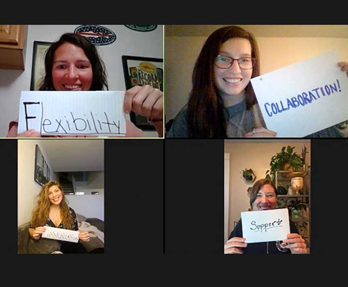 4 video screens of women holding paper signs