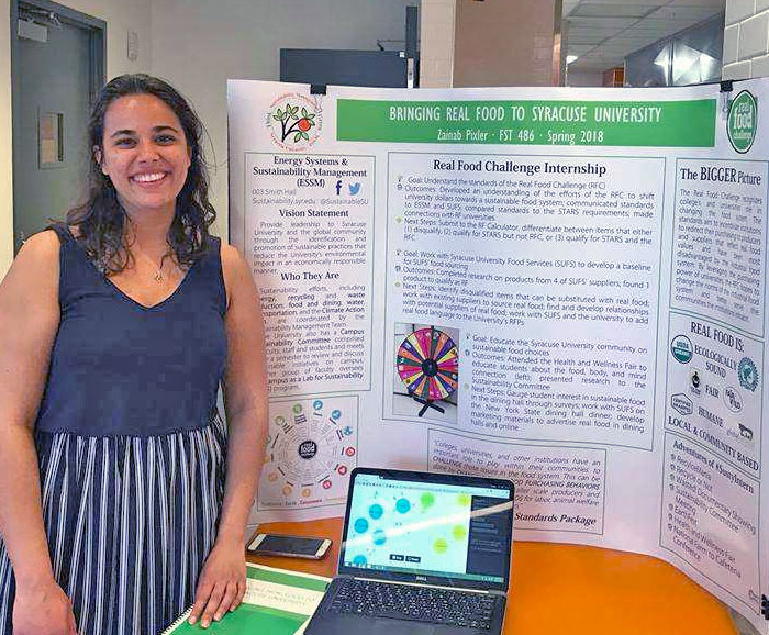 Avery Zainab Pixler stands next to her research poster