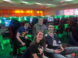 Four students are posed in an esports room