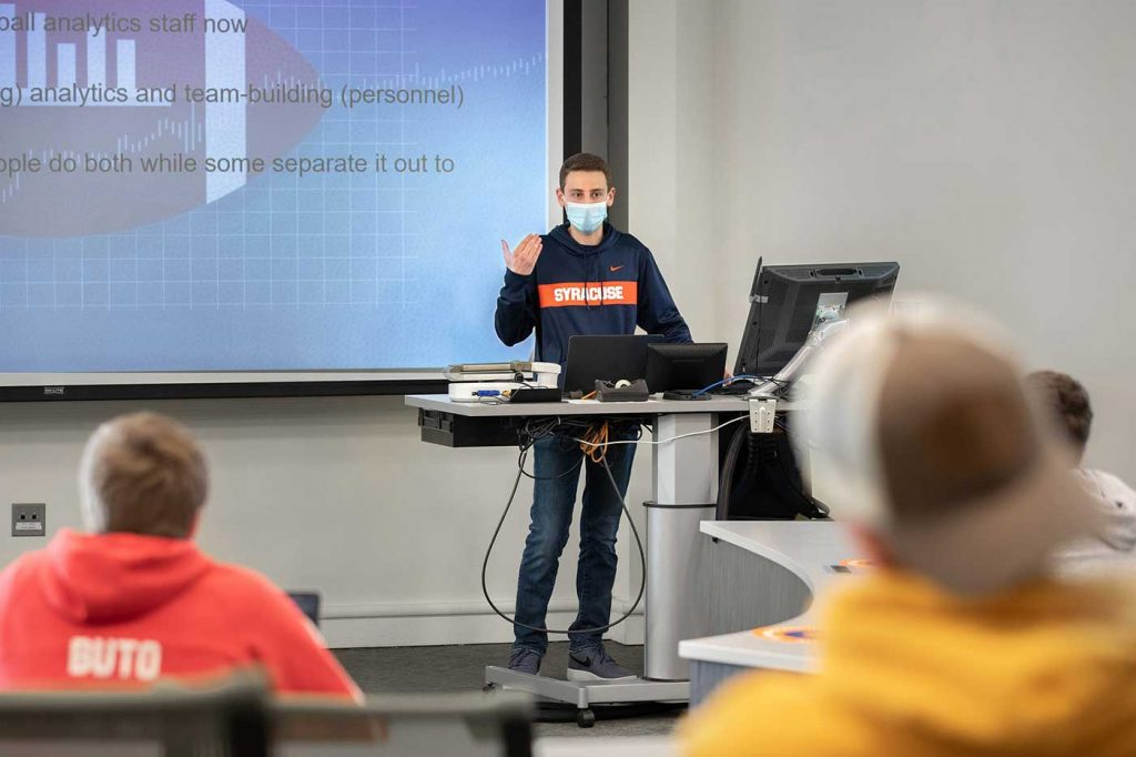 a student lectures in a classroom