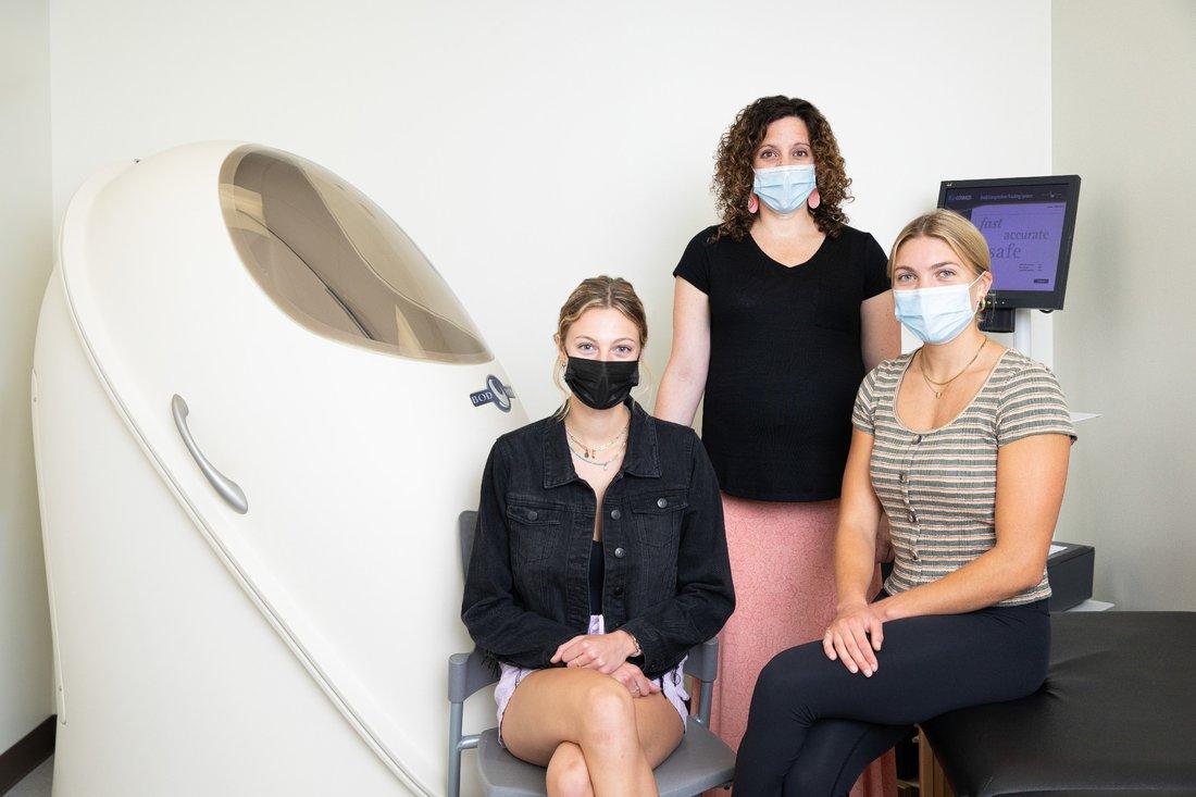 Portrait of Samantha Jezak, Olivia Templeton and Professor Jessica Garay in their research lab.