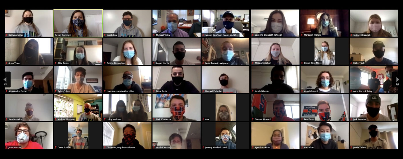 Multiple persons are in a Zoom session with masks on